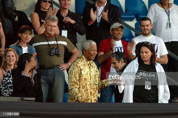 Nelson Mandela and wife Graca Machel during 46664 Give 1 Minute Of Your Life To AIDS Concert Show at Greenpoint Stadium in Cape Town Western Cape...