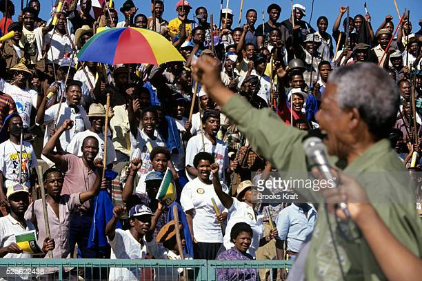 Nelson Mandela appears at an African National Congress campaign rally the month before the first democratic elections in South AfricaAfter more then...