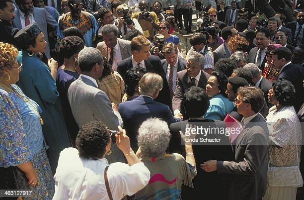 Nelson Mandela arrives at the Martin Luther King Jr. Center and walks through the crowds on Auburn Avenue. In the photograph are the Mayor of...