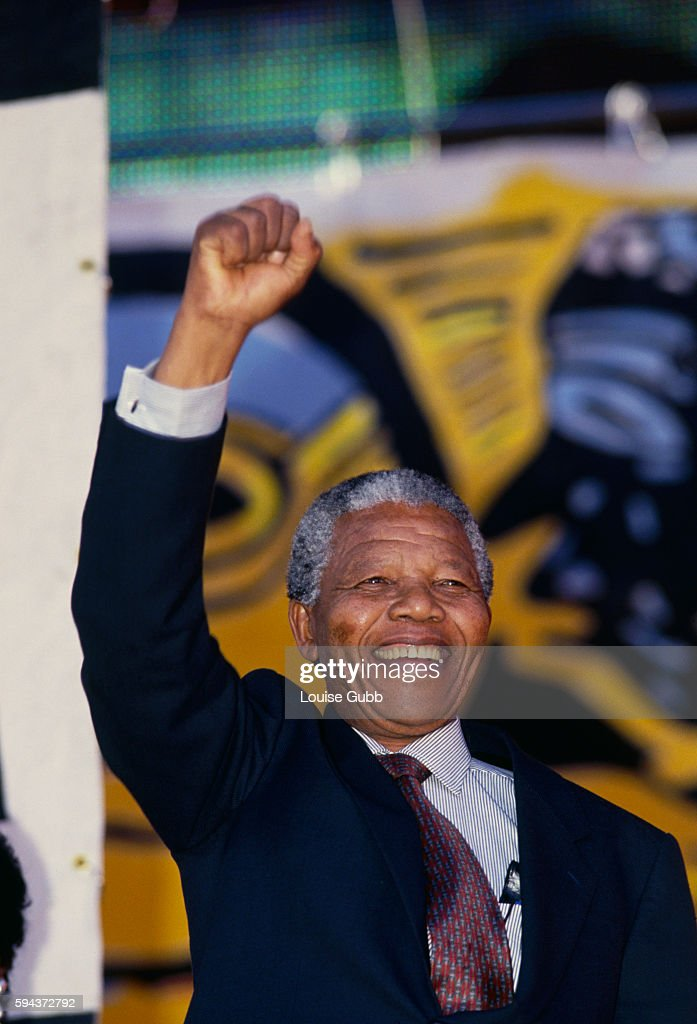 Nelson Mandela celebrating at the Rainbow Concert for Peace and Democracy. Mandela, the former President of South Africa and longtime political prisoner, was held by the Candela based government from 1964-1990 for sabotage. With the coming of a freer political climate, Mandela was released from his life sentence at Victor Vester Prison on February 11, 1990. He went on to lead the African National Congress in negotiations with President F. W. de Klerk that resulted in the end of apartheid and full citizenship for all South Africans. He and de Klerk received a joint Nobel Peace Prize in 1993 for their efforts. Mandela was elected President in 1994.