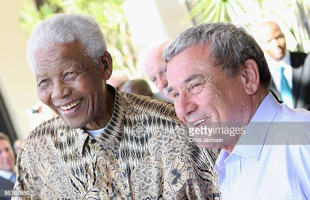 Nelson Mandela greets Sol Kerzner as he arrives at the new OneOnly Cape Town resort on April 2 2009 in Cape Town South Africa Today is the Grand...