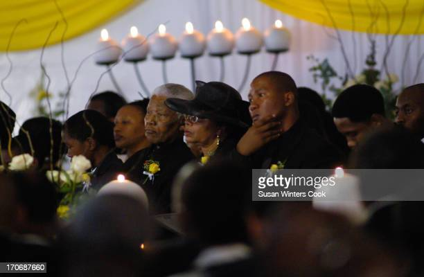 Nelson Mandela his wife Graca Machal and son Mandla along with other family and friends mourn the death of his son Makgatho Qunu South Africa January...