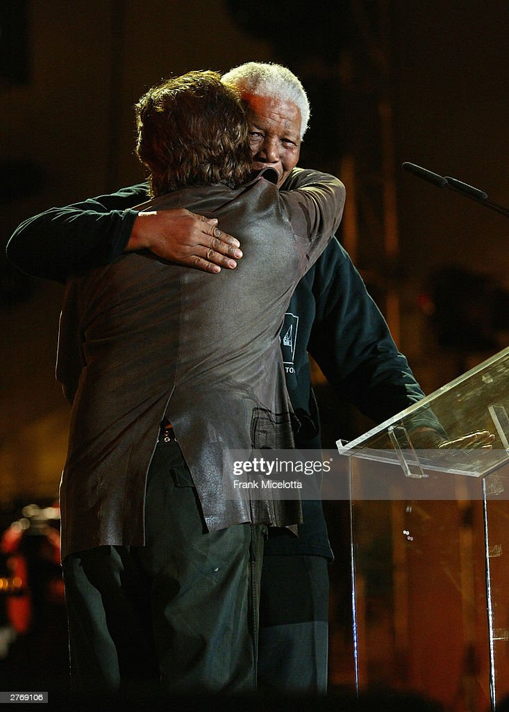 Nelson Mandela hugs singer Bono at the '46664 - Give One Minute of Your Life to AIDS' concert at Greenpoint Stadium on November 29, 2003 in Cape Town, South Africa. The concert will benefit the Nelson Mandela Foundation and the fight against AIDS in Africa.