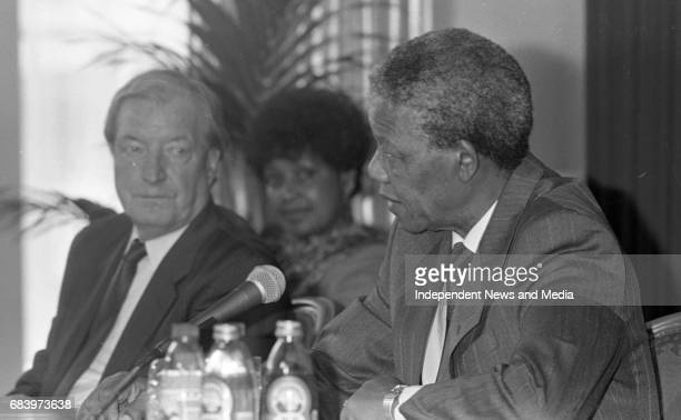 Nelson Mandela is pictured at the joint press conference with An Taoiseach Charles J Haughey at Dublin Castle also pictured is Winnie Mandela