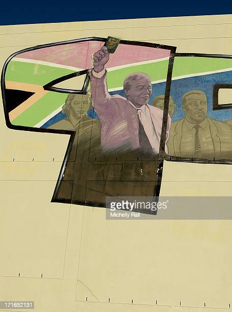 Nelson Mandela is seen holding his passport on a graffiti mural by artist Mak One in District Six which depicts prominent events in South Africa's...