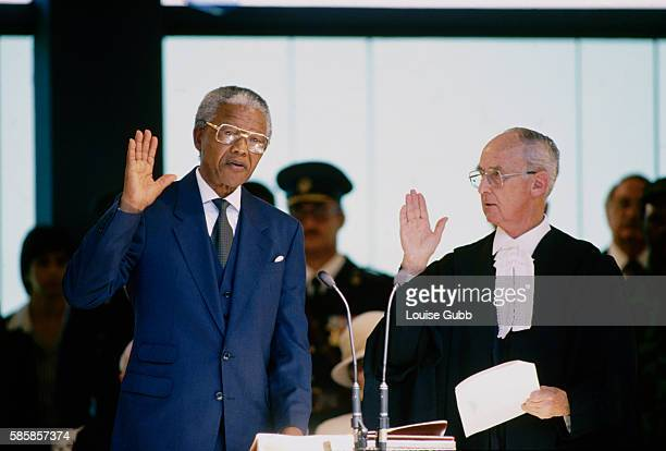 Nelson Mandela is sworn in as the first democratically elected President Former President of South Africa and longtime political prisoner Nelson...