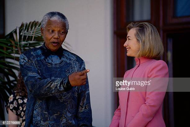 Nelson Mandela jokes with First Lady Hillary Clinton while she is visiting the South African President at his house in Capetown Former President of...