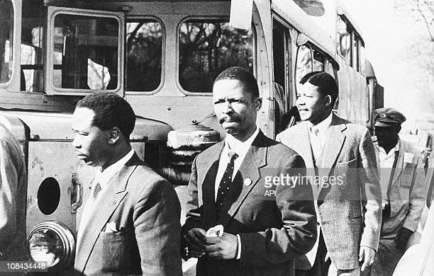 Nelson Mandela leader of the African National Congress Patrick Molaoa and Robert Resha charged with treason by the SouthAfrican Union walked to the...
