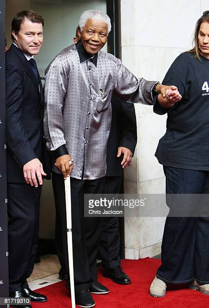 Nelson Mandela leaves the InterContinental Hotel after a photoshoot with celebrity photographer Terry O'Neil on June 26, 2008 in London, England....