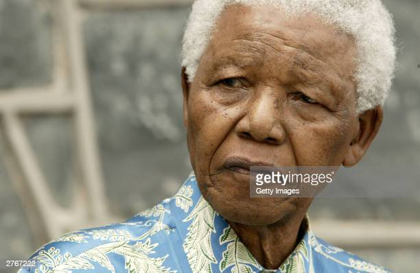 Nelson Mandela listens at a press conference for 46664 Give One Minute of Your Life to AIDS on Robben Island where he was impisoned for 18 years...