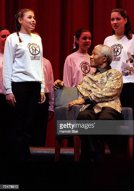 Nelson Mandela listens to the Australian Girls Choir during the World Reconciliation Day Concert at the Colonial Stadium September 8 2000 in...