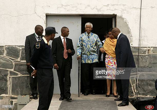 Nelson Mandela makes his way to Robben Island prison courtyard for a press conference for '46664 Give One Minute of Your Life to AIDS' on November 28...