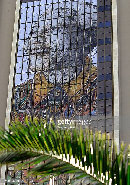 Nelson Mandela murial hangs high at the Cape Town Civic Centre as part of the Nation wide prayers being held for the frail statesman on June 14 2013...