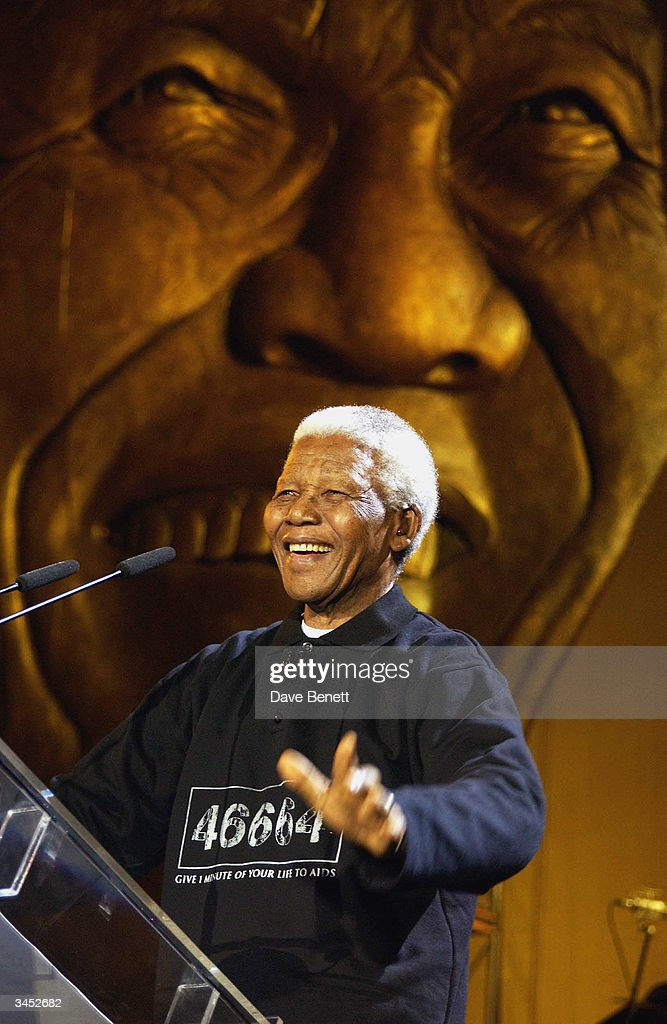 Nelson Mandela performs at The Nelson Mandela Foundation's '46664 Give One minute to Aids' Concert at The Greenpoint Stadium on November 29, 2003 in Cape Town.