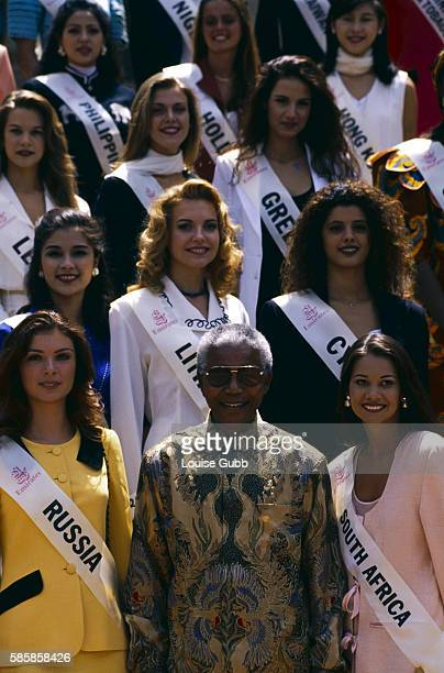 Nelson Mandela poses with Miss World contestants who are in Pretoria for the international beauty pageant President of South Africa and longtime...