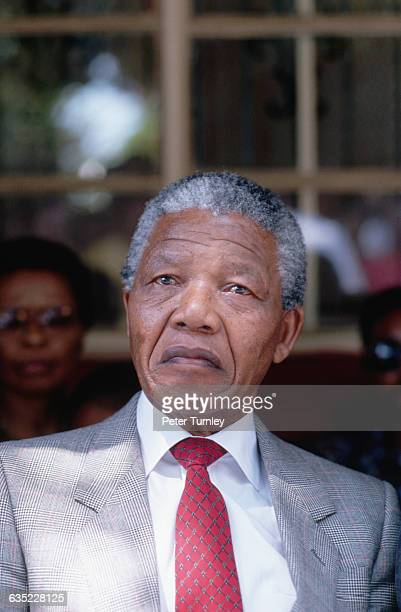 Nelson Mandela relaxes in his backyard after his release from prison