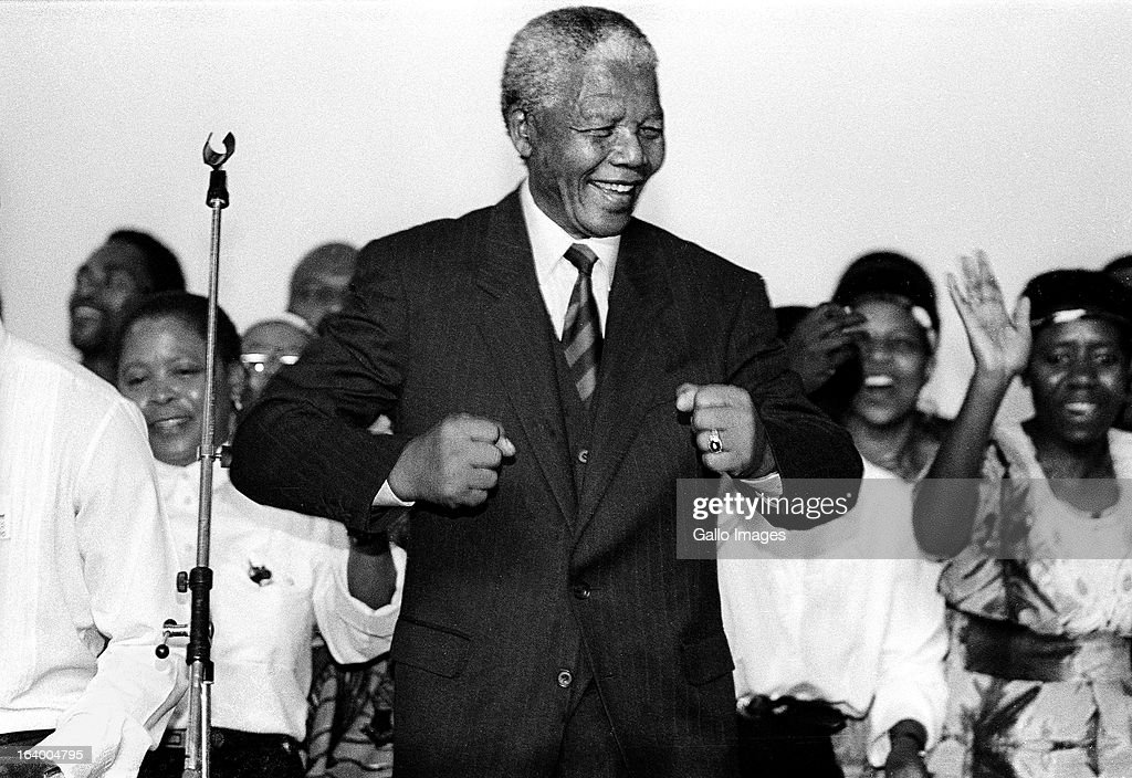 Nelson Mandela smiles as he attends an ANC victory march in 1994 in Johannesburg, South Africa.