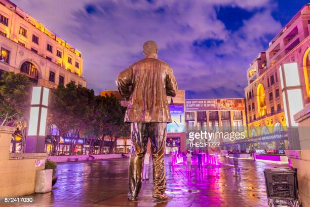 Nelson Mandela Square with the statue from behind