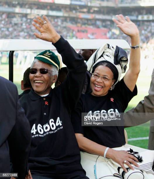 Nelson Mandela the former President of South Africa and his wife Graca Machel receive the applause of the crowd prior to the Nelson Mandela Challenge...