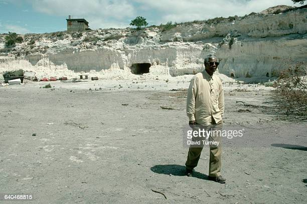 Nelson Mandela visits the lime quarry where he had been forced to do hard labor on Robben Island off the coast of the South African Cape