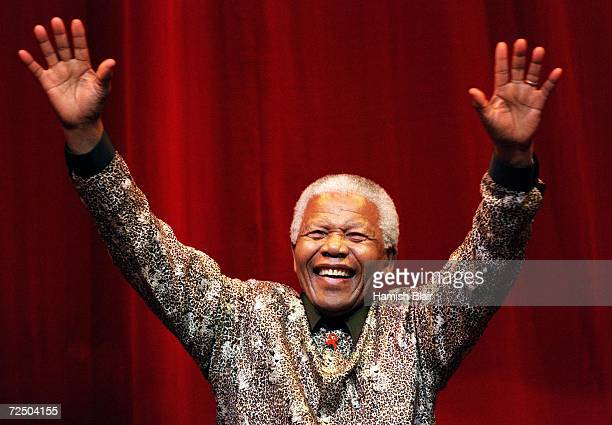Nelson Mandela waves to the crowd after speaking at the Colonial Stadium for the World Reconciliation Day Concert September 8 2000 in Melbourne...