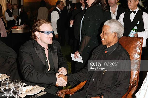 Nelson Mandela with singer Bono at the Thanksgiving Dinner prior to the 46664 concert on November 27 2003 in Cape Town South Africa The concert will...