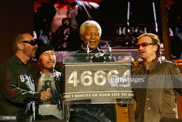 Nelson Mandela with singer Dave Stewart guitarist The Edge and singer Bono at the 46664 Give One Minute of Your Life to AIDS concert at Greenpoint...