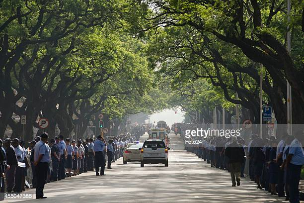 Nelson Mandela's coffin on the corner of Madiba street and Kgosi Mampuru street on it's way back to the Union Buildings on December 11 2013 in...