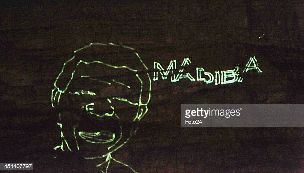 Nelson Mandela's face against Table Mountain on December 8, 2013 in Cape Town, South Africa. World icon, Nelson Mandela passed away quietly on the...