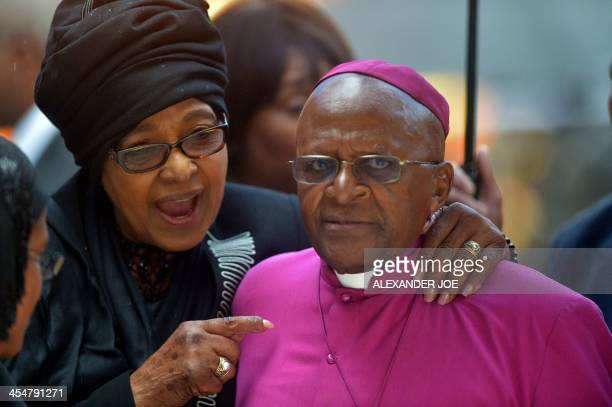 Nelson Mandela's former wife antiapartheid campaigner Winnie MadikizelaMandela speaks with South African Archbishop and Honorary Elders Desmond Tutu...