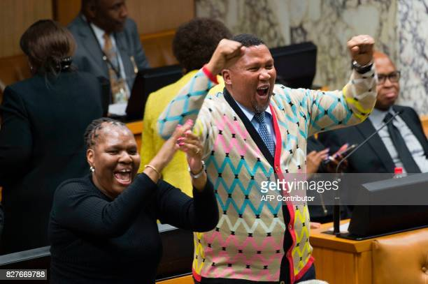 Nelson Mandela's grandson Mandla Mandela cheers after the failure of a noconfidence debate and vote against South African president Jacob Zuma in the...