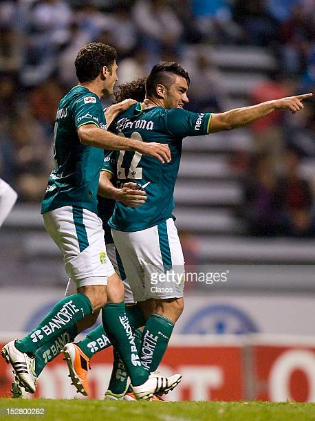 Nelson Maz of Leon celebrates a goal during a match between Puebla and Leon as part of the Apertura 2012 Liga MX at the Estadio Cuauhtemoc on...