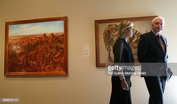 Nelson Meers and daughter Sam Meers with the paintings Central Australia 1950 and Drought Skeleton 1953 both by Australian artist Sidney Nolan They...