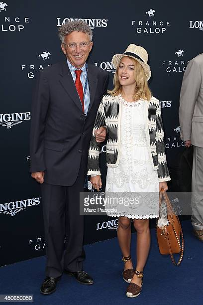 Nelson Monfort and daughter Victoria attend the 'Prix de Diane Longines 2014' at Hippodrome de Chantilly on June 15 2014 in Chantilly France