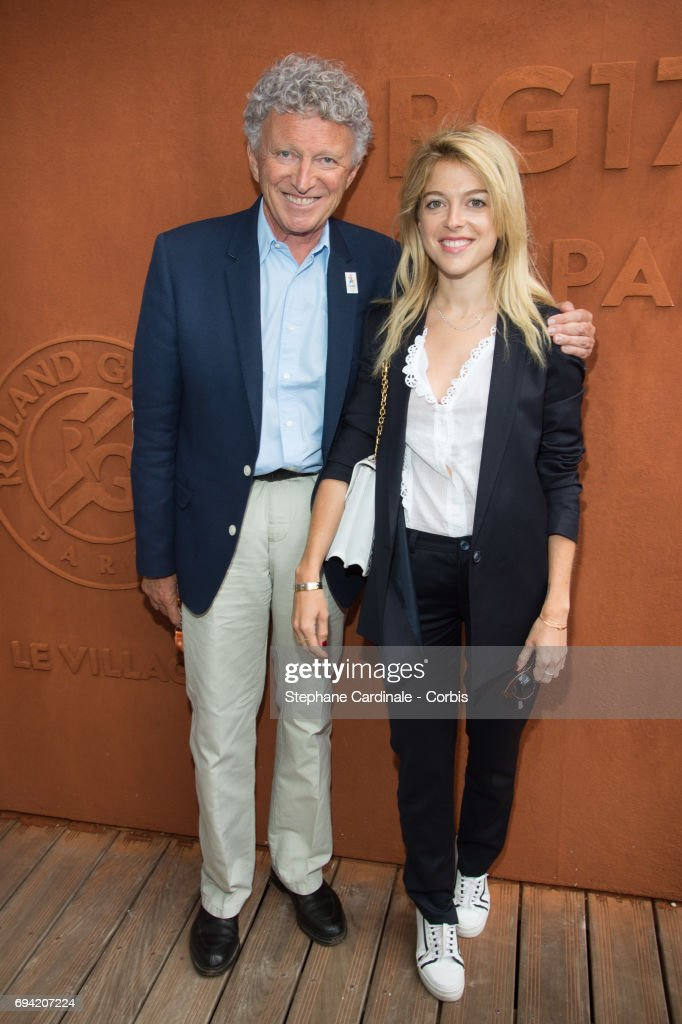 Nelson Monfort and his daughter Victoria Monfort attend the French Tennis Open 2017 - Day Thirteen at Roland Garros on June 9, 2017 in Paris, France.