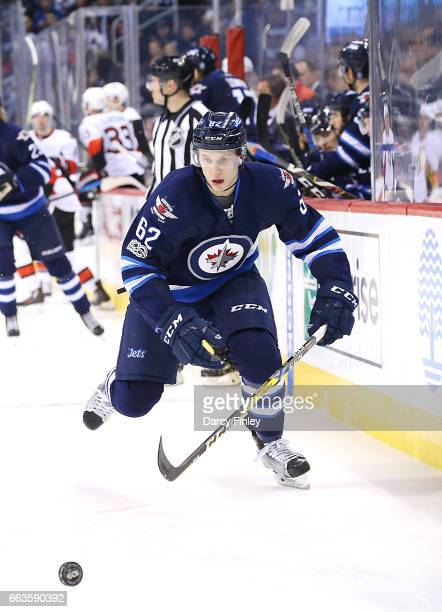 Nelson Nogier of the Winnipeg Jets chases the loose puck down the ice during third period action against the Ottawa Senators at the MTS Centre on...