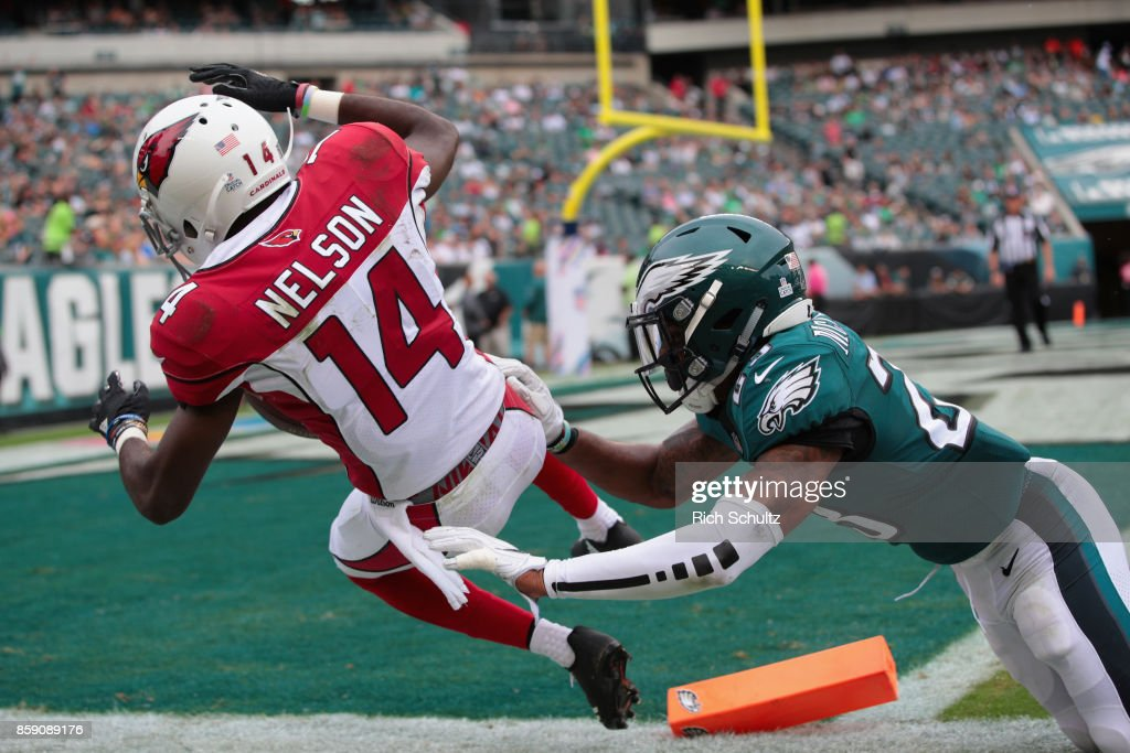 J.J. Nelson #14 of the Arizona Cardinals fumbles the ball past the endzone for a touchback against Rodney McLeod #23 of the Philadelphia Eagles during the fourth quarter at Lincoln Financial Field on October 8, 2017 in Philadelphia, Pennsylvania.