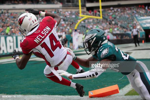 J Nelson of the Arizona Cardinals fumbles the ball past the endzone for a touchback against Rodney McLeod of the Philadelphia Eagles during the...