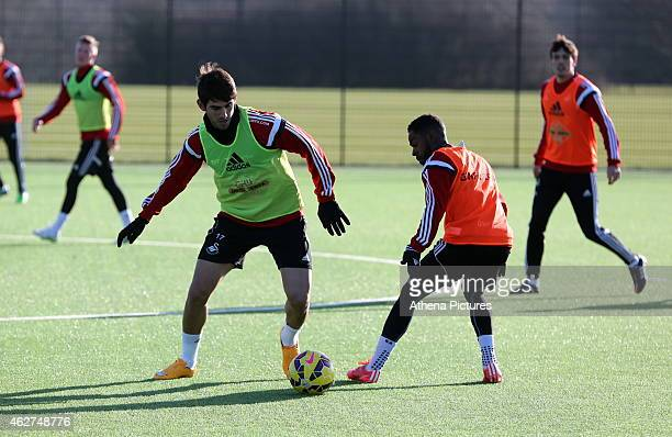 Nelson Oliveira attempts to get past Nathan Dyer during a Swansea City training session at Fairwood training ground on February 4 2015 in Swansea...