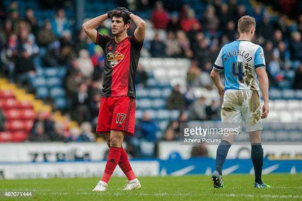 Nelson Oliveira holds his hands on his head after missing a shot on goal during the FA Cup Fourth Round match between Blackburn Rovers and Swansea...