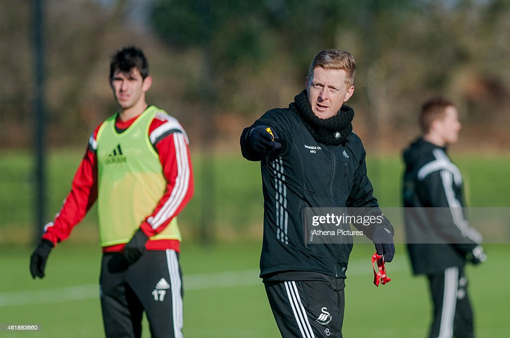 L-R Nelson Oliveira looks on as manager Garry Monk gives instructions during the Swansea City Training Session on January 21, 2015 in Swansea, Wales.
