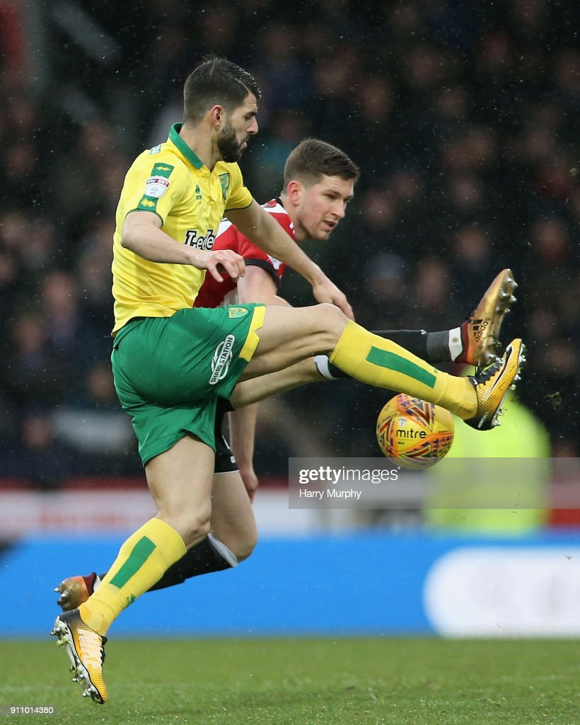 Nelson Oliveira of Norwich City and Chris Mepham of Brentford battle for possession during the Sky Bet Championship match between Brentford and Norwich City at Griffin Park on January 27, 2018 in Brentford, England.