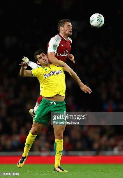 Nelson Oliveira of Norwich City and Mathieu Debuchy of Arsenal in action during the Carabao Cup Fourth Round match between Arsenal and Norwich City...