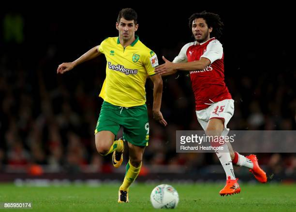 Nelson Oliveira of Norwich City and Mohamed Elneny of Arsenal battle for possession during the Carabao Cup Fourth Round match between Arsenal and...