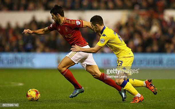 Nelson Oliveira of Nottingham Forest holds off the challenge from Lewis Cook of Leeds United during the Sky Bet Championship match between Nottingham...