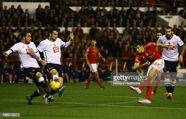 Nelson Oliveira of Nottingham Forest scores their first goal during the Sky Bet Championship match between Nottingham Forest and Derby County at City...