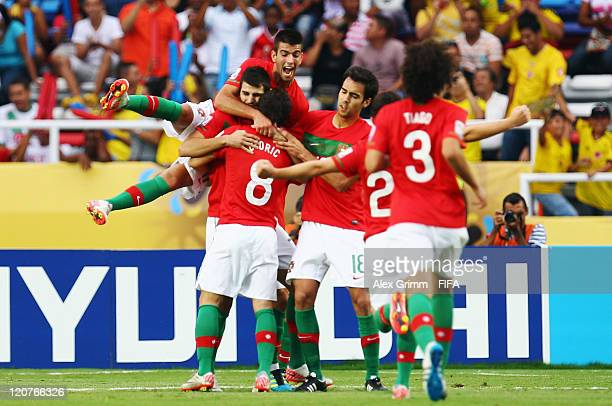 Nelson Oliveira of Portugal celebrates his team's first goal with team mates during the FIFA U-20 World Cup 2011 round of 16 match between Portugal...