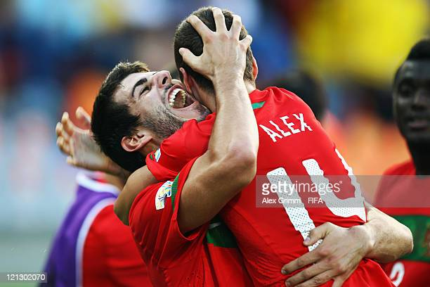 Nelson Oliveira of Portugal celebrates his team's second goal with team mate Alex during the FIFA U-20 World Cup 2011 semi final match between France...