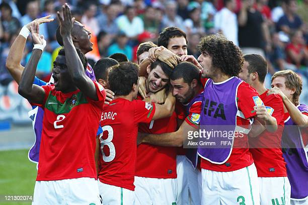 Nelson Oliveira of Portugal celebrates his team's second goal with team mates during the FIFA U-20 World Cup 2011 semi final match between France and...