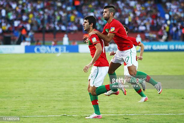 Nelson Oliveira of Portugal celebrates his team's second goal with team mate Sergio Oliveira during the FIFA U-20 World Cup 2011 semi final match...